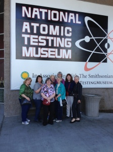 Gwen Woolf, left, with other NPFW members at the National Atomic Testing Museum this spring following a board meeting.